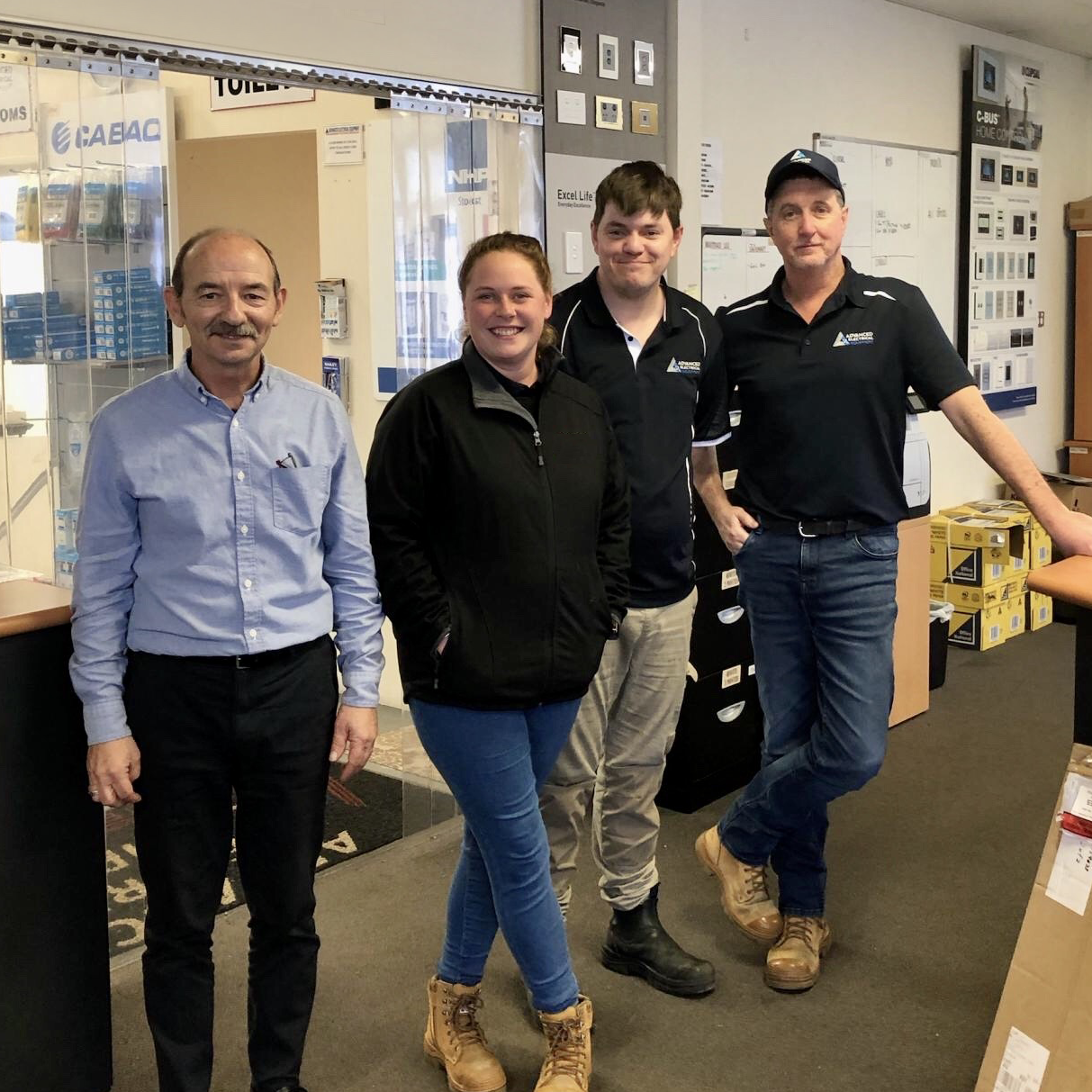 Picture of Russell, Michelle, Nathan and Paul standing together in Bunbury branch.